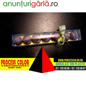 Imagine anunţ Cutie plastic 7 bomboane ciocolata Process Color